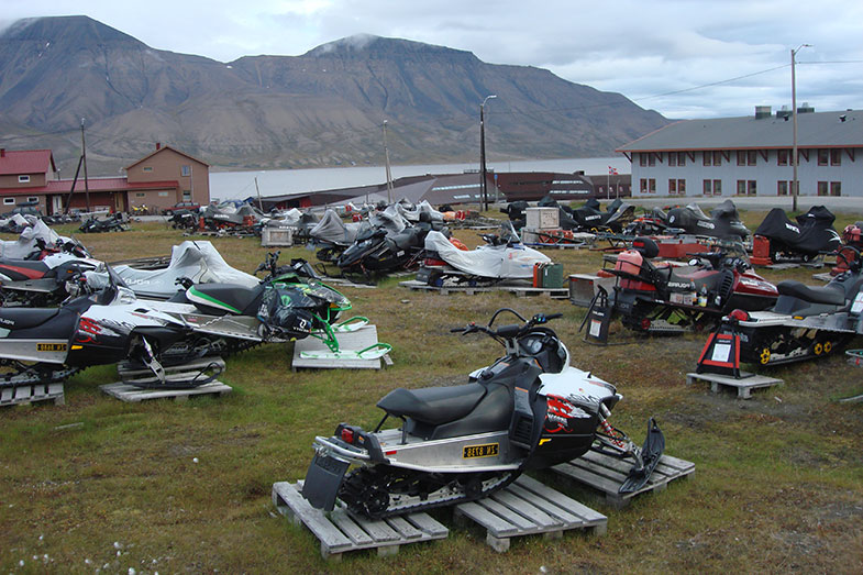 Parked Snowmobiles in the Summer