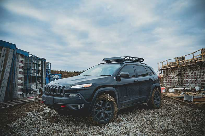 Black Off-Road Jeep with Dirty Wheels
