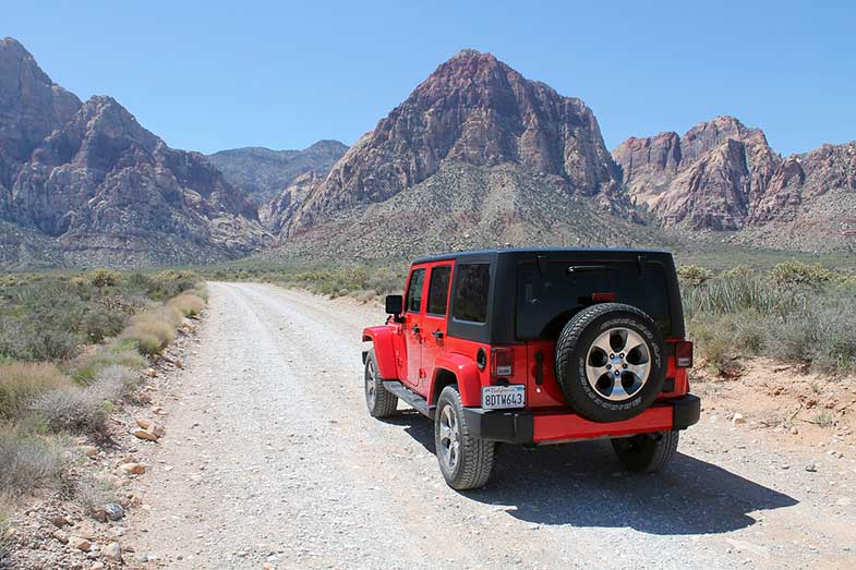 Red Jeep Wrangler in the Desert