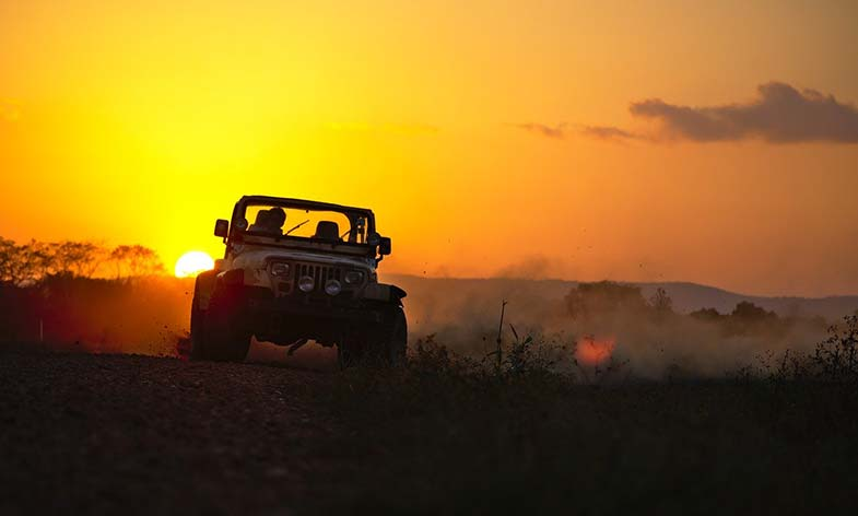 Jeep Creating Dust While Drifting During Sunset