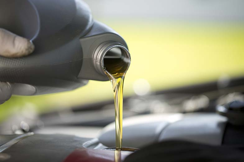 Motor Oil Being Poured into Car Engine