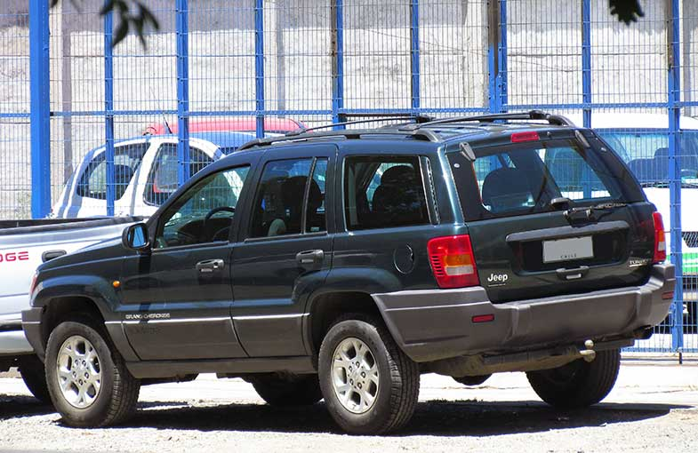 Jeep Grand Cherokee with Roof Rack in Parking Lot