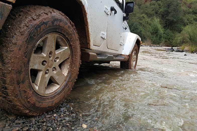 Jeep Wrangler Off-Road 4x4 Driving Through Creek