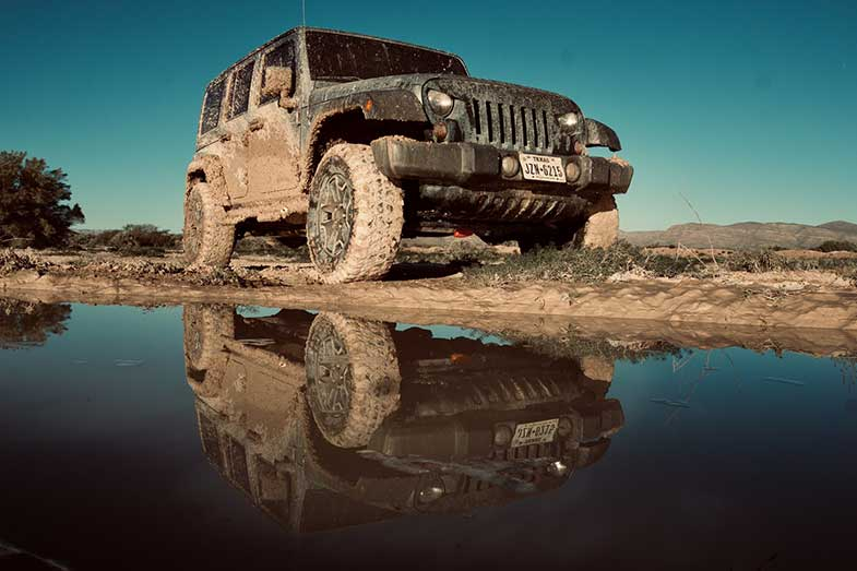 Muddy Black Jeep Wrangler with Texas License Plate