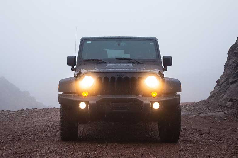Black Jeep Wrangler in the Rain