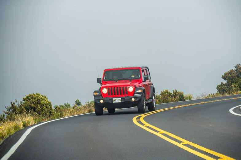 Red Jeep Wrangler on Road