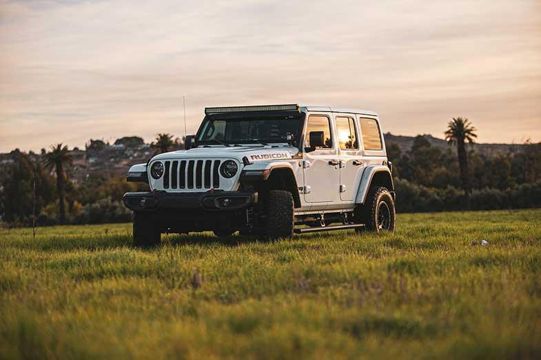 White Jeep Wrangler Rubicon on Grass