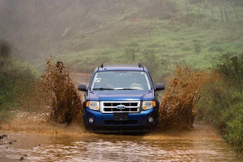 Blue Car Driving Through Mud