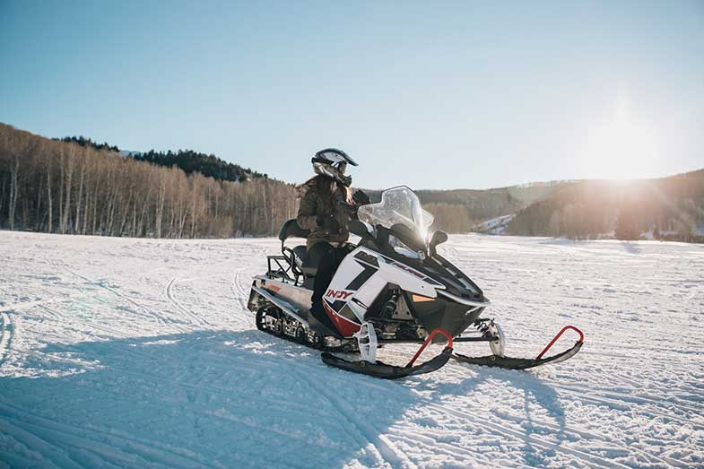 Girl Riding Snowmobile During the Day
