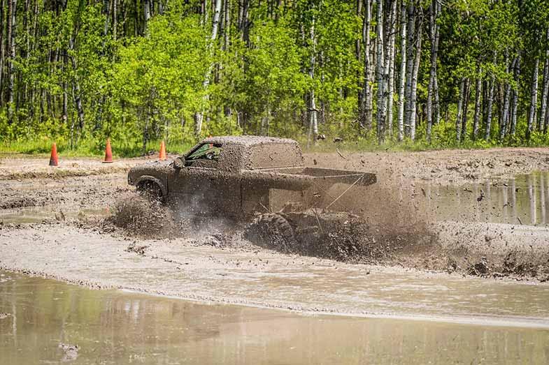 Off-Road Truck Driving Through Mud Bog