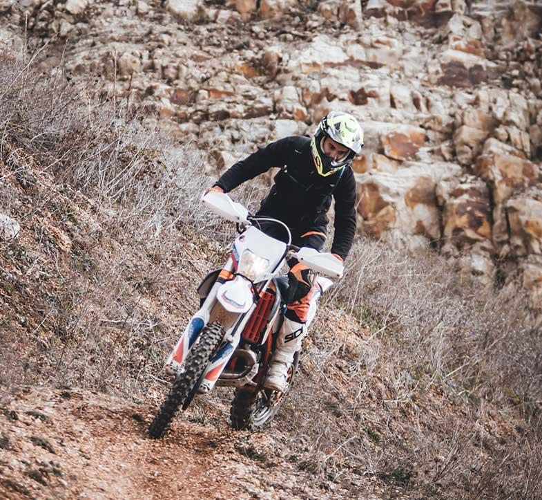 Person Driving Motocross Dirt Bike