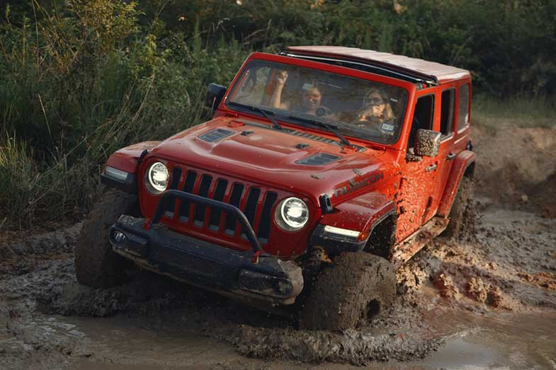 Red Jeep Wrangler Rubicon Mud Trail