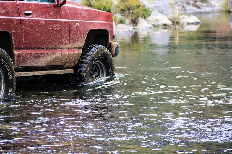 Red Off-Road Vehicle in Water