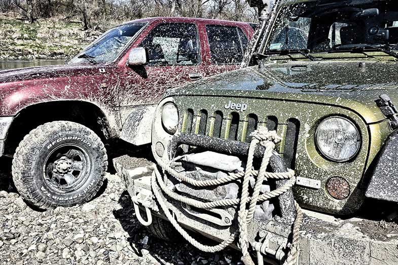 Two Muddy Off-Road Vehicles