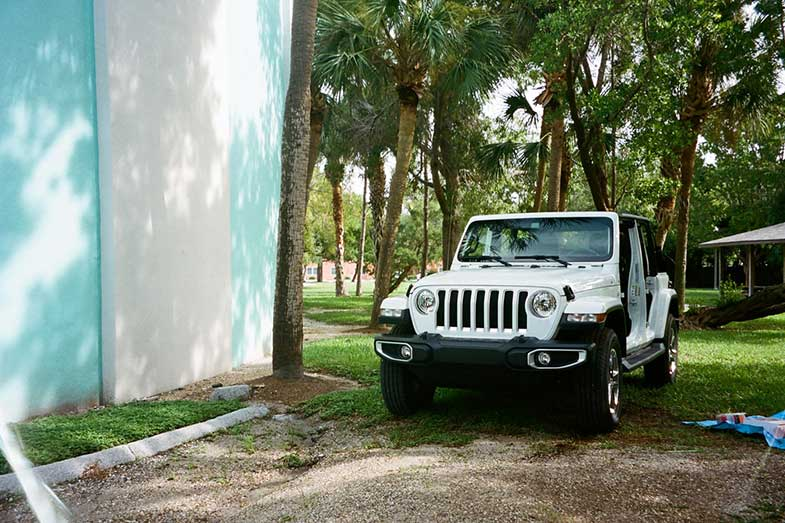 White and Black Jeep Wrangler Parked