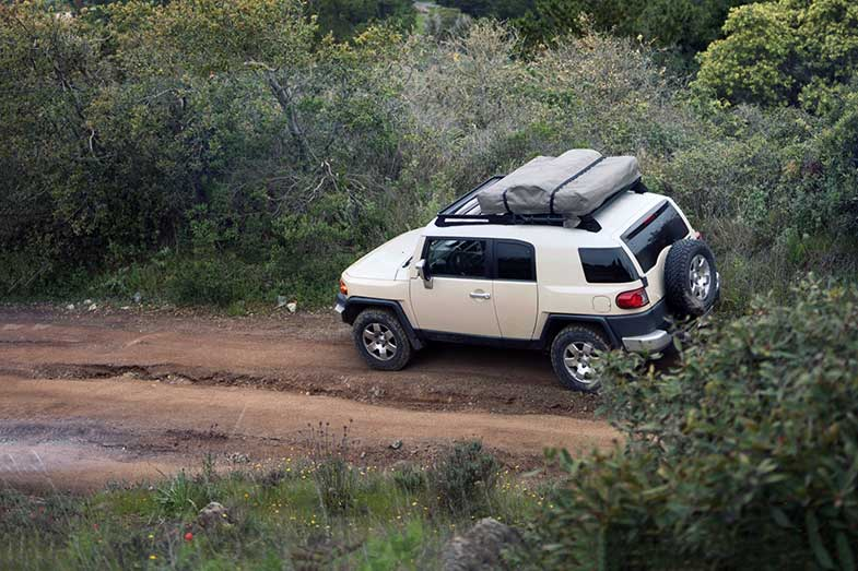 White Car Parked on Off-Road Trail