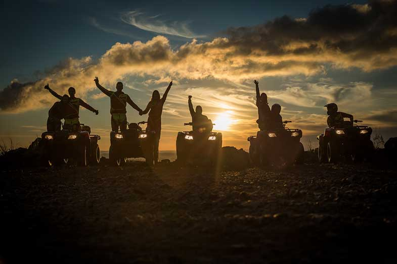 Group of ATV Riders During Sunset