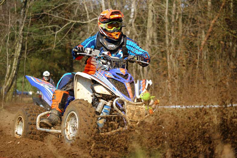 ATV Rider with Orange Helmet