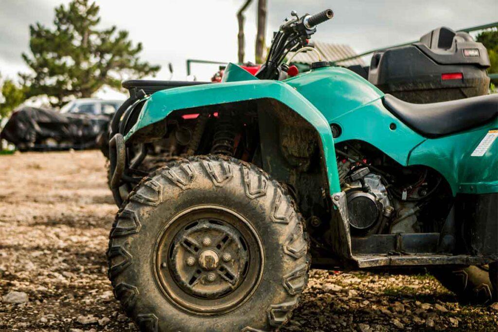 Green ATV in Parking Lot