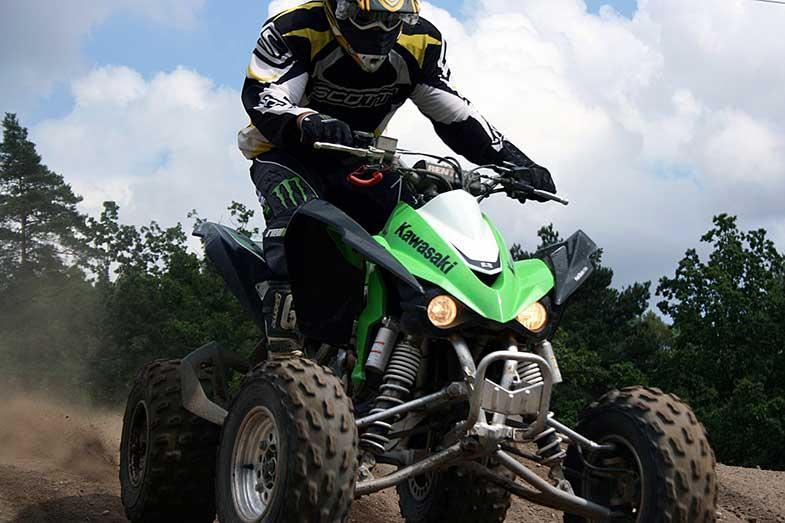 Green Kawasaki ATV Quad on Sand