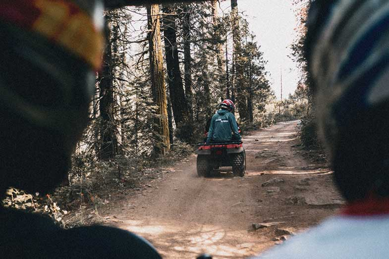 People Riding ATV Quad on Dirt Path Off-Road