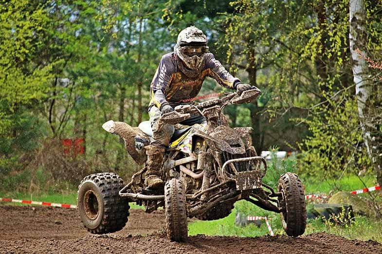 Person Riding Muddy ATV Quad