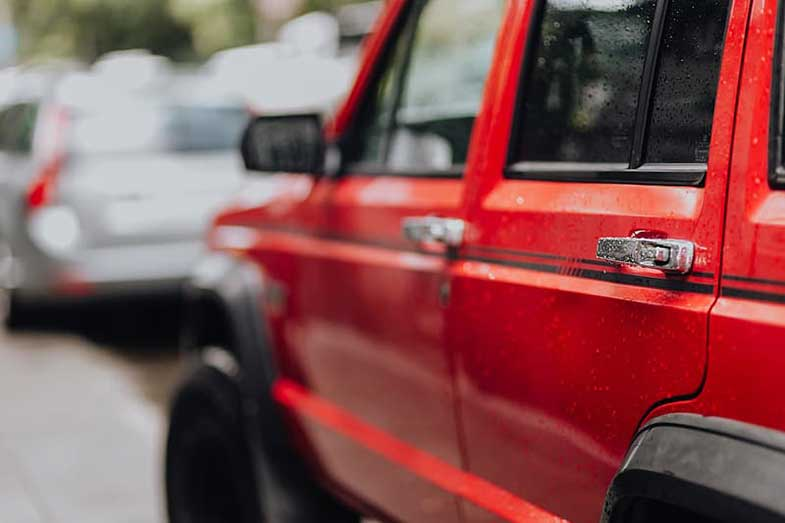 Red Jeep Cherokee in the Rain