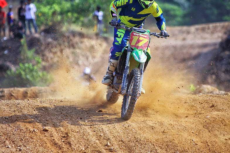 Riding Green Dirt Bike During Daytime