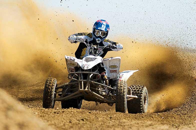 Riding White ATV in the Desert