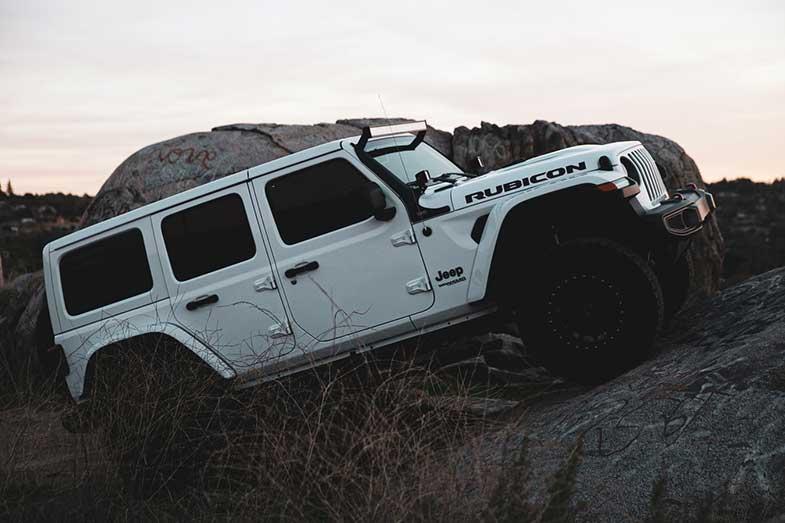White Jeep Wrangler Rubicon on Rock