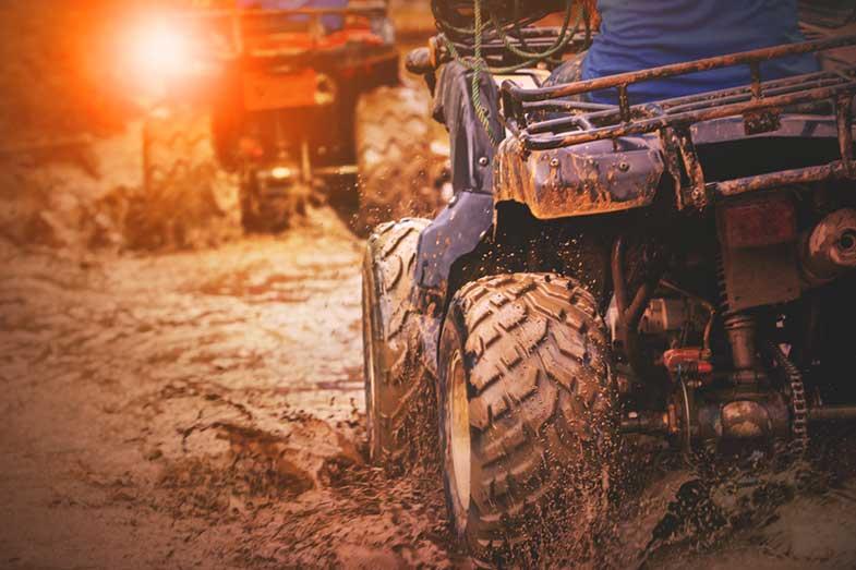 ATV Quad Bike Riding Through Mud Track