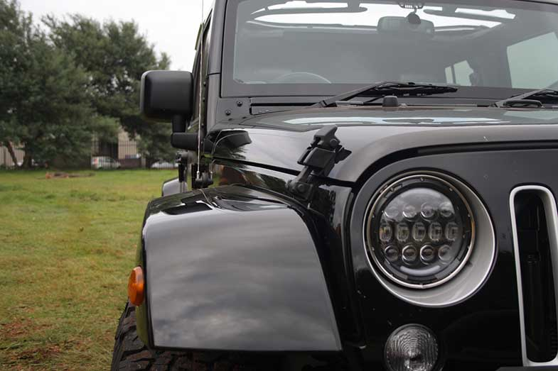 Black Jeep Wrangler Headlight Close-Up