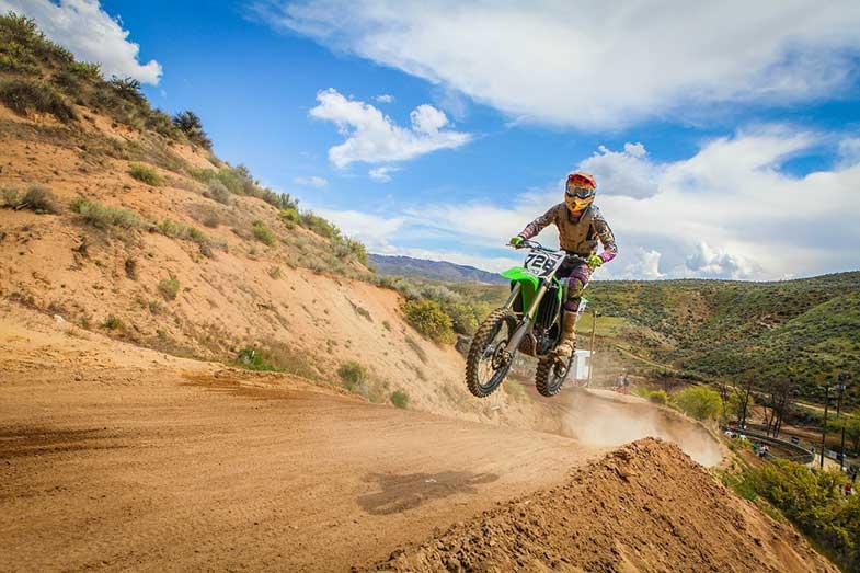 Green Dirt Bike Rider Hill Jump