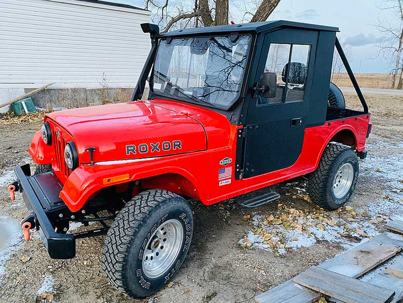Red 2018 Mahindra Roxor with Aftermarket Hard Cab
