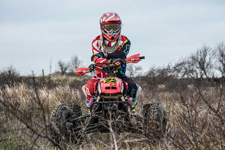 ATV Rider with Arms Crossed on Trail