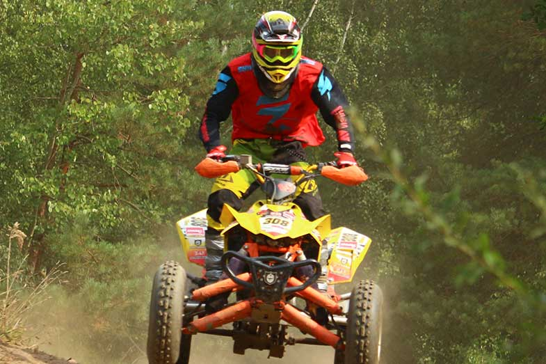 ATV Rider with Red Shirt Driving Yellow Quad
