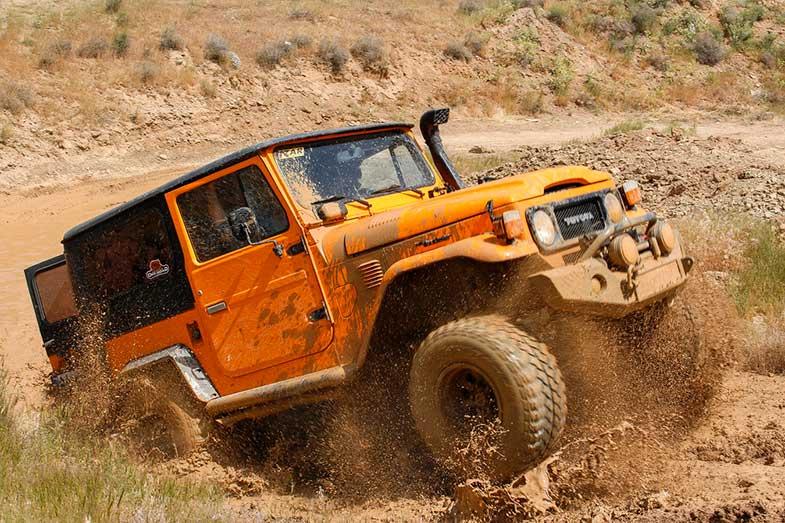 Orange SUV Muddy Terrain Off-Road