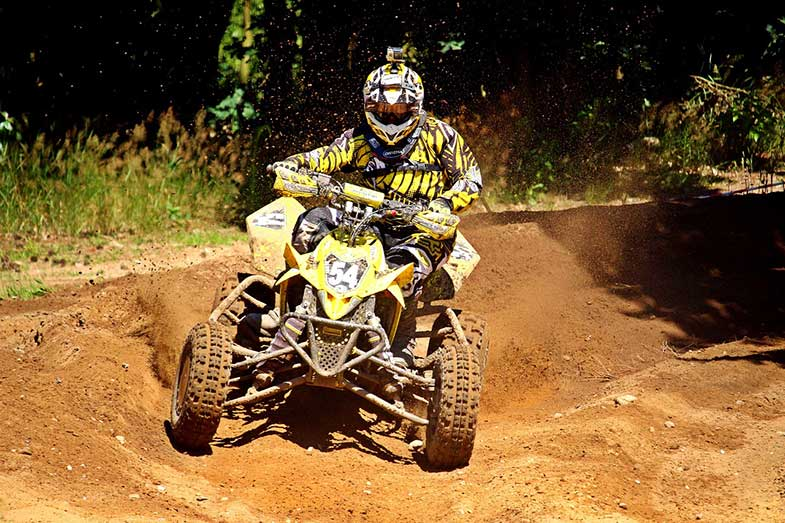 Yellow ATV Quad Turning Corner