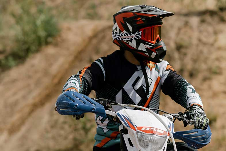 Dirt Bike Rider with Helmet and Goggles