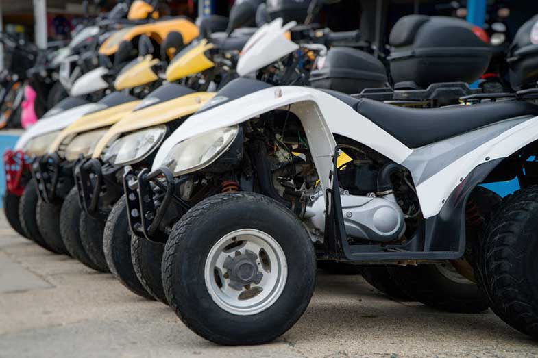 All-Terrain Vehicles Parked on the Street