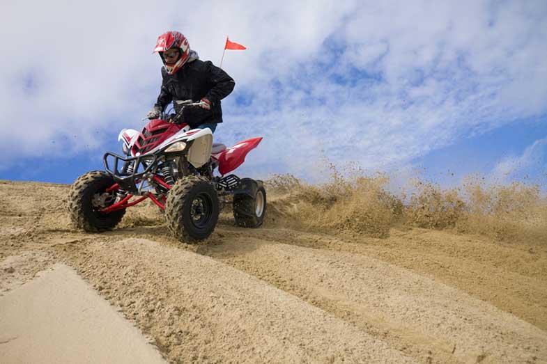 ATV Rider Spinning Tires in Sand