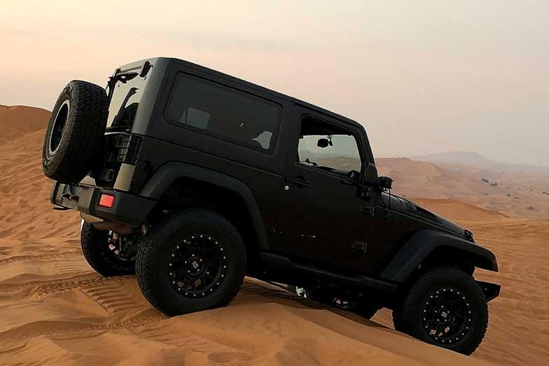 Black Jeep Wrangler on Sand Dunes