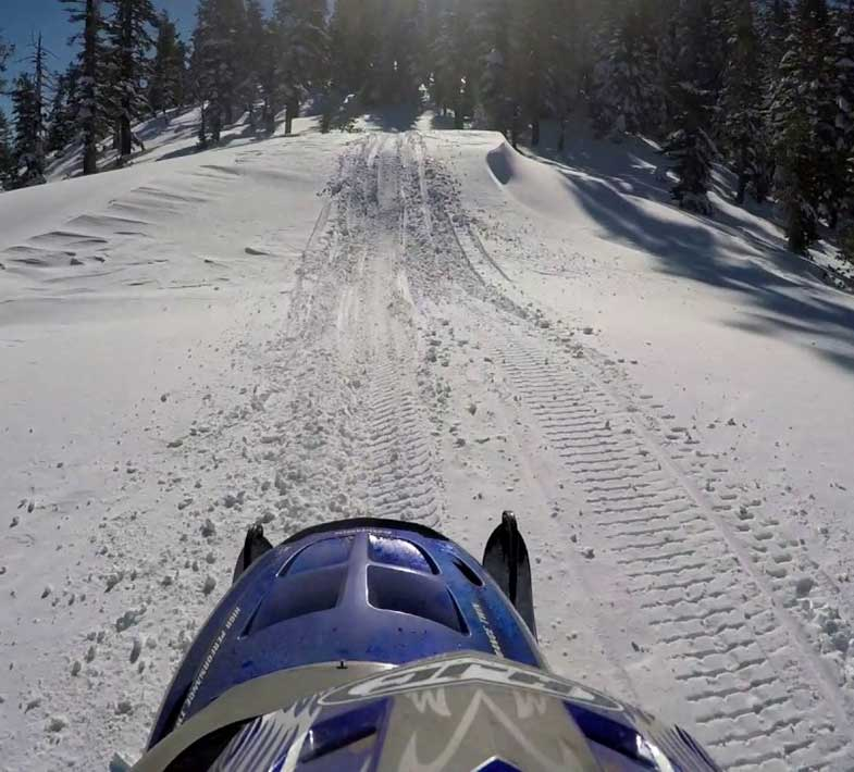 Blue Sled on Snowmobile Trail