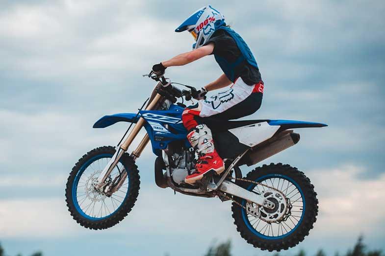 Blue Yamaha Dirt Bike Rider Jump