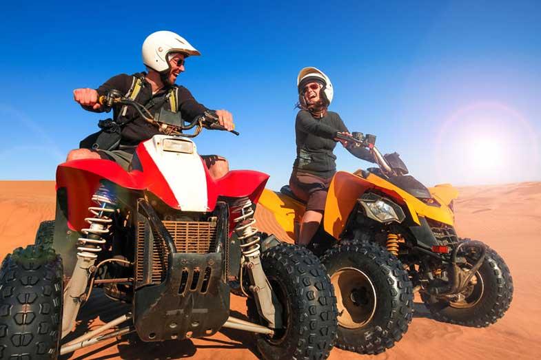 Happy People Riding ATV Quad Bikes