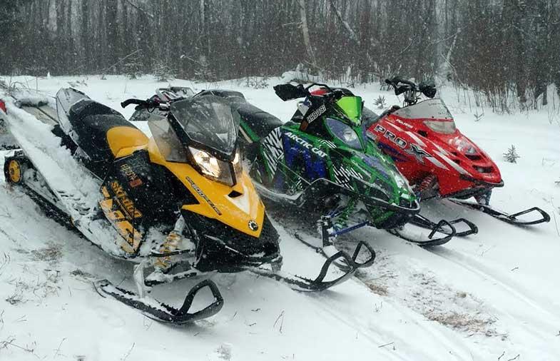 Three Snowmobiles in Minnesota