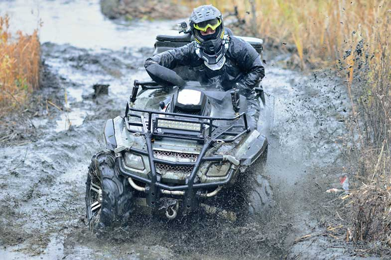 ATV Driving in Mud and Water