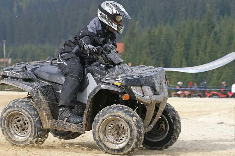 ATV Rider in Black Turning Corner