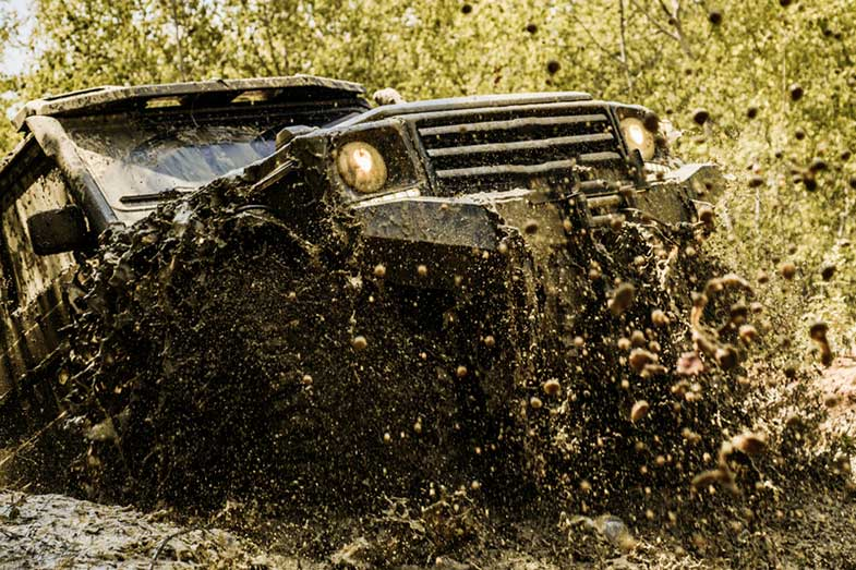 Off-Road Mudding Vehicle Splash