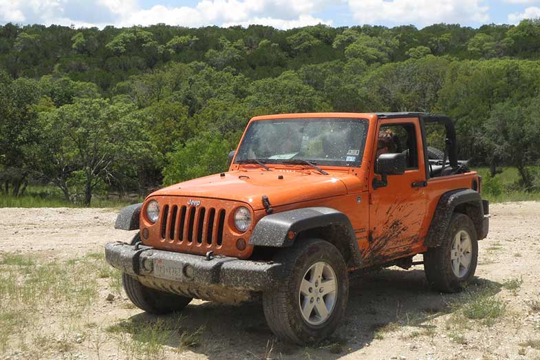 Orange Jeep Wrangler Sport at Hidden Falls Adventure Park in Marble Falls, Texas